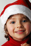 Little santa claus. Little girl with santa claus hat stock images