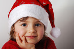 Little santa claus. Little girl with santa claus hat royalty free stock photos