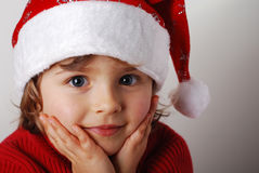 Little santa claus. Little girl with santa claus hat Stock Image
