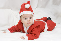A little Santa Claus on the bed. Royalty Free Stock Images