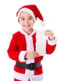 Little Santa Claus boy showing wishlist Stock Image