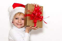 Little Santa Claus with a gift Royalty Free Stock Photo