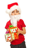 Little Santa Claus with gifts Stock Photo