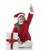A little santa claus girl that indicates Royalty Free Stock Photo