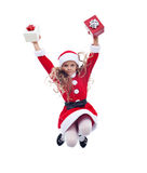 Little santa claus girl jumping high with presents Stock Photo
