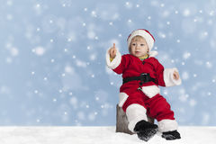 Little santa claus outdoors in the snow Royalty Free Stock Photography