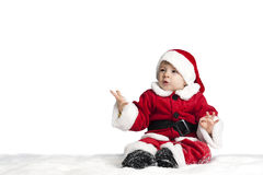 Little santa claus seated in the snow Stock Photos
