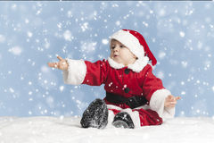 Little santa claus in the snow Stock Images