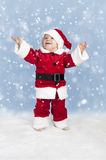 Little santa claus in the snow Stock Photos