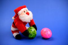Little Santa Claus With And Pink Easter Egg Royalty Free Stock Photos