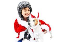 Little santa with dog reindeer Royalty Free Stock Photos