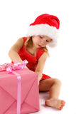 Little Santa girl with gift Royalty Free Stock Photos