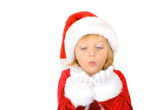 Little Santa helper is blowing snowflake Royalty Free Stock Photography