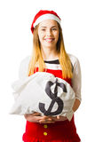 Little santa helper with dollar sign money bag. Isolated photo of a smiling little santa helper holding dollar sign money bag. Seasonal saving Royalty Free Stock Photos