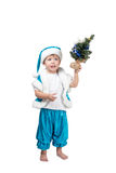 Little Santa holding a Christmas tree in his hand Royalty Free Stock Photo