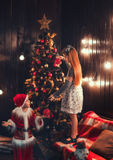Little Santa with the little girl stock photos