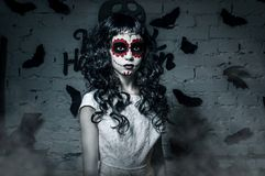 Little santa muerte girl with black curly hair Stock Image