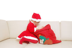 Little santa with red sack full of presents Royalty Free Stock Image
