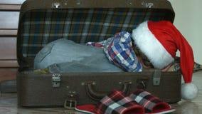 Little Santa sleeping in suitcase. stock footage