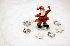 Little Santa on snow. With stellar in his hand stock image