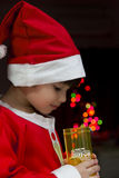 Little Santa - young mixed race boy wearing santa claus costume Royalty Free Stock Photos