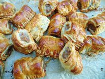 Little Sausage Rolls on baking Paper stock photo
