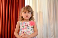 The little scared girl cries in the kindergarten hall royalty free stock images