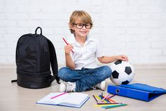 Little school boy in glasses doing homework Royalty Free Stock Photography