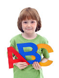 Little school boy with large letters Stock Photo