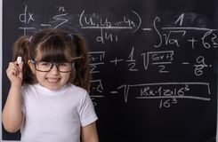 Little school girl in classroom. Clever kid. Clever kid in school. Back to school. Smart kid. Education concept royalty free stock images