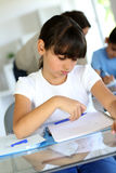Little school girl doing lessons getting bored Royalty Free Stock Image