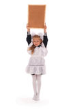 Little school girl hold empty chalkboard Royalty Free Stock Images