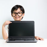 Little school girl with laptop Royalty Free Stock Images
