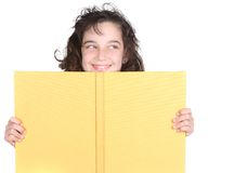 Little School Girl Looking Over Her Book Royalty Free Stock Photo