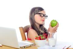 A little school girl looks apple Stock Photos