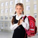Little school girl. Portrait of schoolgirl with red satchel. Education and school concept Royalty Free Stock Image