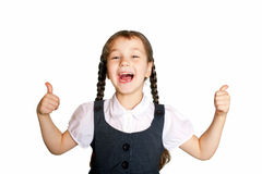 Little school  girl showing thumbs up. Back to school! Isolated on a white background Stock Photos