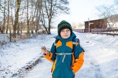 Little school kid boy of elementary class walking to school. Stock Images