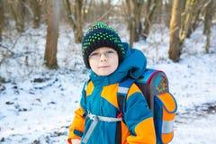 Little school kid boy of elementary class walking to school. Royalty Free Stock Image