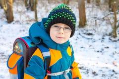 Little school kid boy of elementary class walking to school. Stock Photo