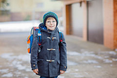 Little school kid boy of elementary class walking to school. Royalty Free Stock Photography