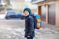 Little school kid boy of elementary class walking to school. Stock Photos