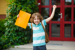 The little school student rejoices to beginning of summer vacation. Stock Photo