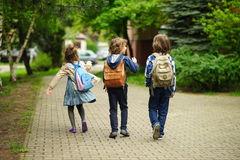 Little school students hurry on occupations. Royalty Free Stock Photo