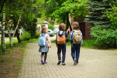 Little school students hurry on occupations. Royalty Free Stock Photos