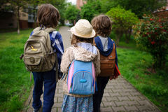 Little school students hurry on occupations. Royalty Free Stock Image