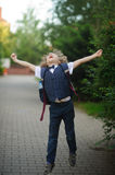 Little schoolboy as if flying. Stock Images