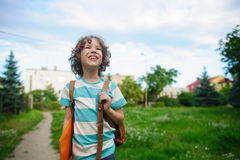 Little schoolboy comes back from school in good mood. Royalty Free Stock Photos