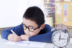 Little schoolboy drawing in the classroom Royalty Free Stock Photography