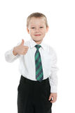 Little schoolboy holds his thumb up Royalty Free Stock Image